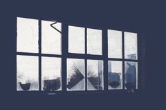 Broken glass at Window of old industrial building Royalty Free Stock Photo