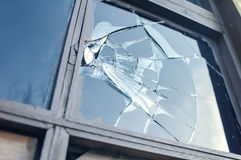 Broken glass. Window reflecting blue sky royalty free stock photography