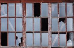 Broken glass window ruins background. Broken glass window ruins in an abandoned old house background Stock Image