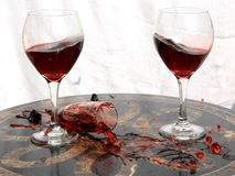 Broken glass and wine. Broken glass with red wine on the table Royalty Free Stock Image