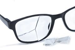 Broken glasses on awhite background. concept of failure. Broken glasses on a white background stock photography