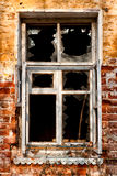 Broken glasses. The old house looks empty eye-sockets of wooden windows Stock Photos