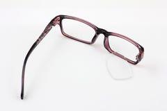 Broken glasses one leg Royalty Free Stock Photography