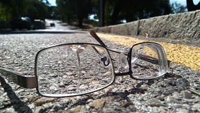 Broken glasses on the road Stock Images