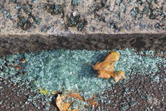 Broken glasses. Small pieces of broken glasses under a footstep Royalty Free Stock Photos