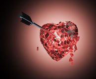 Broken glossy metallic heart with arrow Royalty Free Stock Photo
