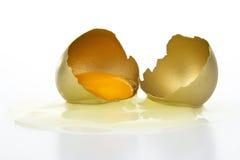 Broken gold egg. On white background Royalty Free Stock Image