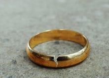 Broken gold wedding band Royalty Free Stock Photos