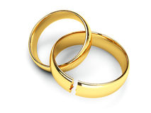 Broken gold wedding rings Royalty Free Stock Photo