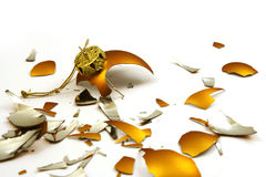 Broken golden ball. Pieces of broken golden ball on white, christmas background Stock Photos