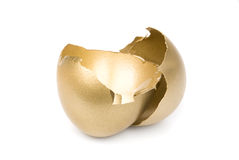 Broken golden egg. A broken, empty golden eggshell on a white background with missing financial reward inside Royalty Free Stock Photos