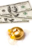 Broken golden egg and dollars. Concept of financial risk Royalty Free Stock Image