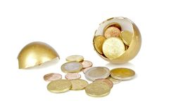 Broken golden egg with euro coins. On a white background Royalty Free Stock Images