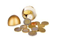 Broken golden egg and euro money. On a white background Royalty Free Stock Images