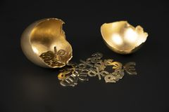 The broken Golden egg, and from it poured out the Golden symbols of the dollar, Euro, profit stock image