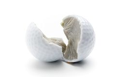 Broken golf ball Royalty Free Stock Photography
