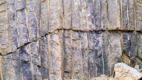 Broken granite stone wall Royalty Free Stock Photo
