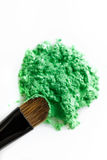 Broken green eye shadow and makeup brush isolated on white background Stock Photo