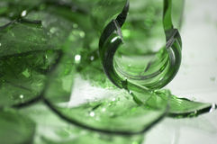 Broken green glass. A pile of broken green glass with selective focus on a piece in the middle Royalty Free Stock Photo