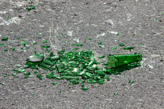 Broken Green Glass car window ground Royalty Free Stock Image