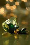 Broken Green and Gold Holiday ornament Stock Photography