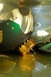 Broken Green and Gold Holiday ornament Royalty Free Stock Photos