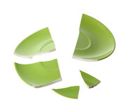 Broken green plate. On white background royalty free stock images
