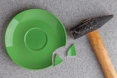 Broken green plate Royalty Free Stock Image