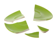 Broken green plate on white Stock Image