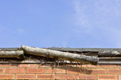 Broken gutter Stock Photo