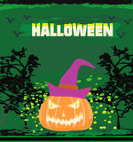 Broken halloween pumpkin on grunge green background Royalty Free Stock Images