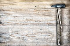 Hammer with a broken handle. Broken hammer. Hammer with a broken handle on a wooden background Royalty Free Stock Photo
