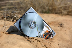 Broken hard drive in sands Stock Image