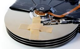 Broken hard drives with a band-aid Stock Images