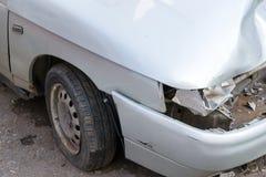 Broken Headlight on Silver Car Stock Image