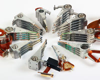 Broken headstacks of old hard drives Stock Photo