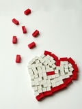 Broken Heart. The image of a heart composed by pieces of a ruler for children learning to count Royalty Free Stock Photos