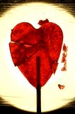 Broken heart. A broken red candy lolly pop heart. Concept for Valentines Day royalty free stock image