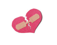 Broken Heart. Broken paper heart held together with a bandaid Stock Image