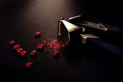 Broken heart. Cinnamon heart broken by a press garlic Stock Photos