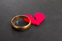 Broken heart. Gold wedding ring and red broken heart ( divorce concept Stock Images