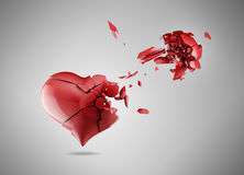 Broken heart. Red broken heart isolated on gray Royalty Free Stock Photos