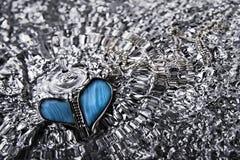 Broken heart. With falling water-drop Stock Image