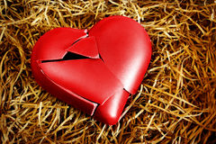 Broken Heart. Photo with a broken heart protected with straws Stock Images