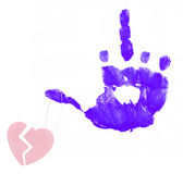 Broken heart on angry finger. Hand making flip with broken heart dangling from thumb Stock Photo