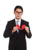 Broken heart Asian businessman Stock Images