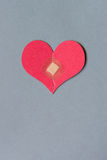 Broken heart with bandage. Broken heart combined with a square bandage Stock Photos