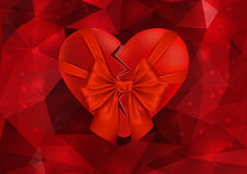Broken heart with bow Stock Images