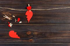 Broken heart breakup collection and divorce icon. Red paper shaped as a torn love , health care problems due to illness. Broken lo. Ve concept royalty free stock image