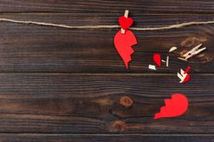 Broken heart breakup collection and divorce icon. Red paper shaped as a torn love , health care problems due to illness. Broken lo. Ve concept Royalty Free Stock Photo